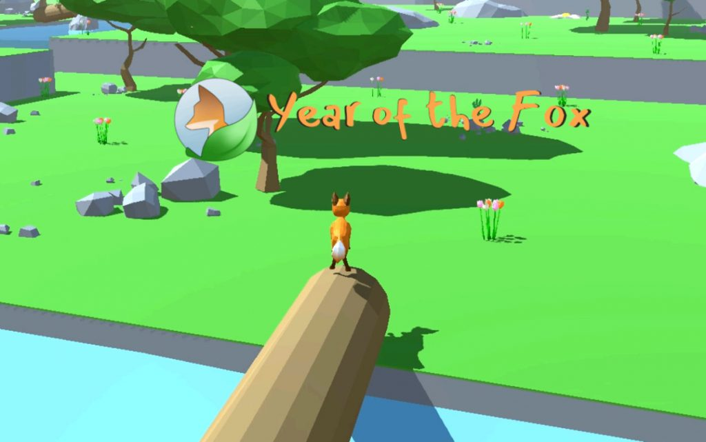 Ein Screenshot aus dem Spiel. Ein Fuchs steht auf einem umgekippten Baum, der über einem Fluss liegt