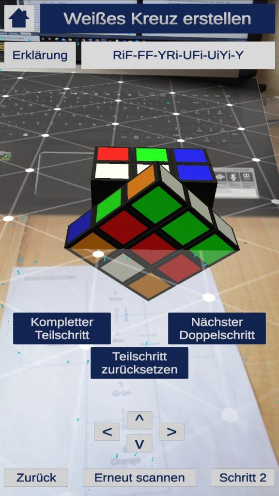 Ein virtueller Zauberwürfel der überdeckt über einem Kamerabild liegt